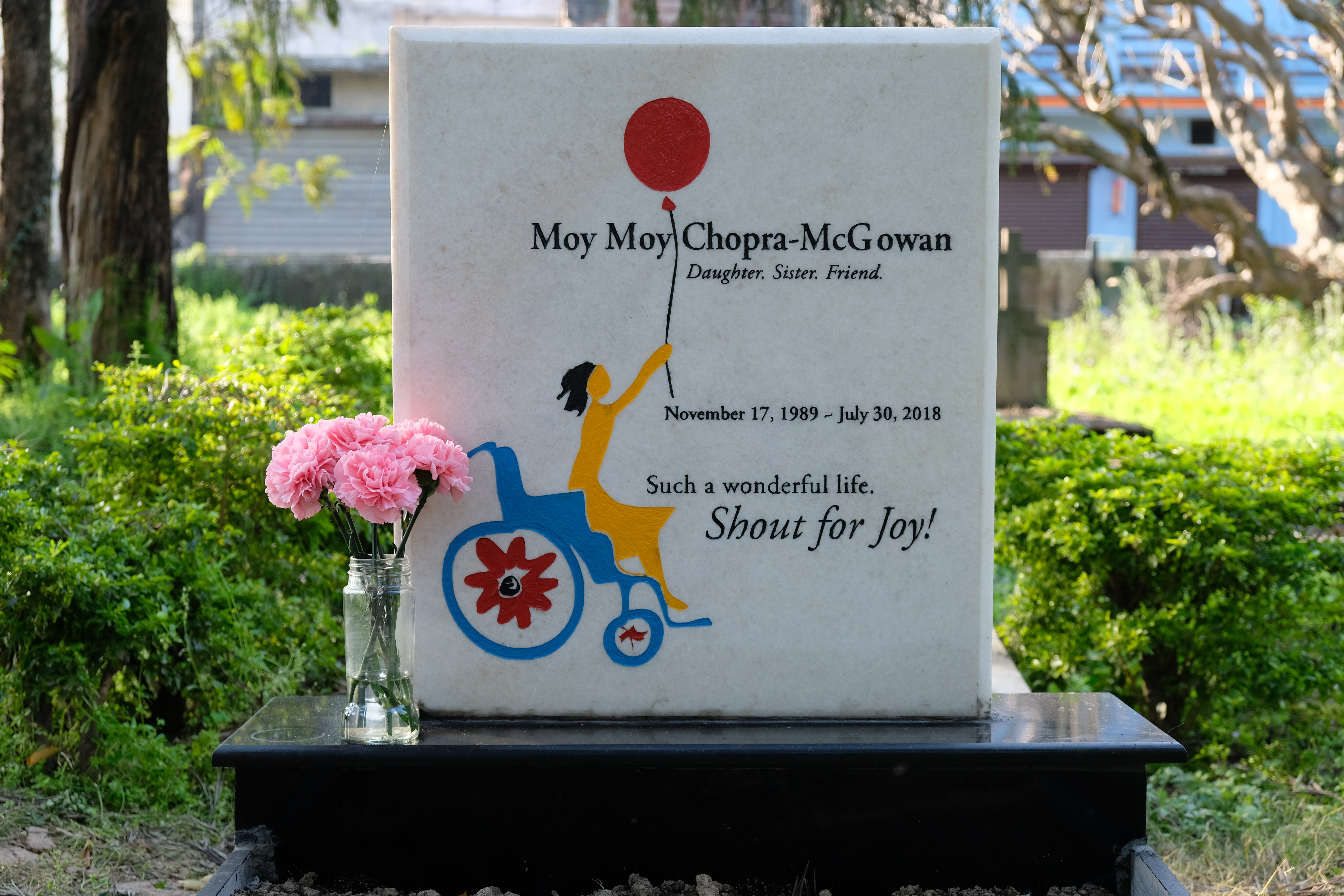 White marble gravestone. Text reads Moy Moy Chopra McGowan Daughter. Sister. Friend. 1989 - 2018 Such a wonderful life. Shout for Joy!