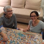 Older woman and younger woman doing a jigsaw puzzle