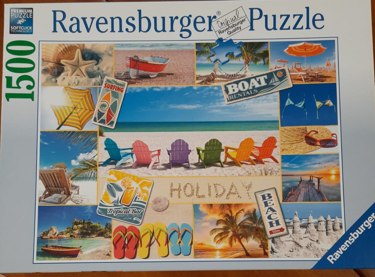 Ravensburger jigsaw puzzle box, depicting a montage of summer beach scenes