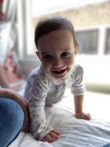 Smiling baby, crawling away